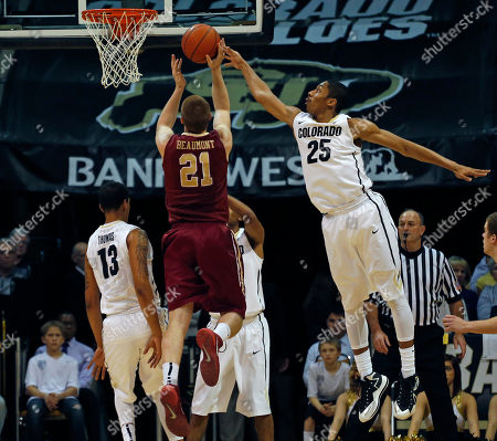 Spencer Dinwiddie, Ryley Beaumont Colorado's Spencer Dinwiddie, right, tips away a shot by Elon's Ryley Beaumont during the first half of an NCAA college basketball game in Boulder, Colo