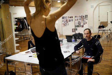 Josep Font Josep Font, creative director of DelPozo, looks over a model during a model casting in New York