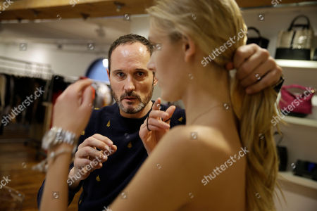 Josep Font Josep Font, creative director of DelPozo, left, fixes a model's hair during a model casting in New York