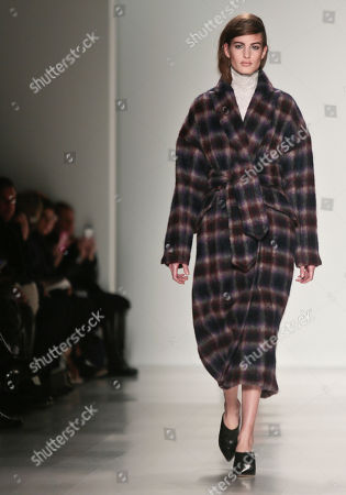Stock Photo of Richard Chai Love Fashion from the Richard Chai Love Fall 2014 collection during New York Fashion Week. Lucky magazine style editor Laurel Pantin says trends for cooler weather include baby blue outerwear, shearling coats, oversized sweaters, plaids, black-and-white prints, straight trouser pants, hiking boots, blanket coats and Pendleton prints