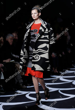 Stock Picture of An outfit from the Fall 2014 Diane von Furstenberg collection during Fashion Week in New York. Lucky magazine style editor Laurel Pantin says trends for cooler weather include baby blue outerwear, shearling coats, oversized sweaters, plaids, black-and-white prints, straight trouser pants, hiking boots, blanket coats and Pendleton prints