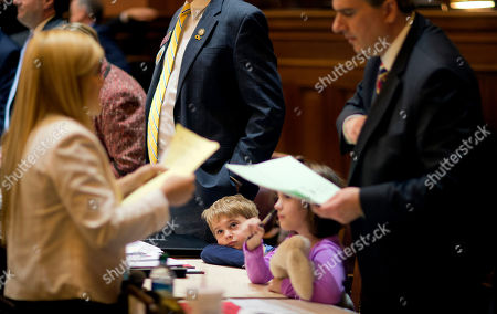 Stock Image of Jack Carson, John Carson, Elizabeth Carson Jack Carson, 4, left, looks up while joining his father Georgia Rep. John Carson, R - Marietta, right, and his sister Elizabeth, 5, at the first day of the legislative session, in Atlanta. State lawmakers have returned to the Capitol, and the 2014 legislative session is underway. Much of the lawmakers' business on Monday was ceremonial, making preparations for the 40-day session