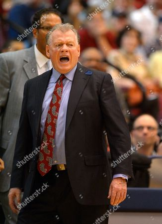 Stock Image of Max Good Loyola Marymount head coach Max Good yells to his team during the first half of an NCAA college basketball game against Gonzaga, in Los Angeles