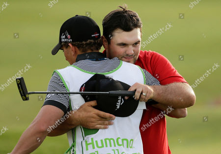 Patrick Reed, Kessler Karain Patrick Reed, right, hugs his caddie Kessler Karain after winning the Humana Challenge golf tournament on the Palmer Private course at PGA West in La Quinta, Calif. Reed left everyone behind last year in the Humana Challange. This year, he's trying not to get too far ahead of himself