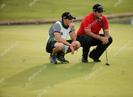 Patrick Reed, Kessler Karain Patrick Reed, right, lines up a putt with his caddie Kessler Karain on the 18th hole at the Humana Challenge golf tournament on the Palmer Private course at PGA West in La Quinta, Calif. Reed won the tournament by two shots