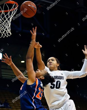 Alexis Smith, Jamee Swan Illinois' Alexis Smith, left, shoots while blocked by Colorado's Jamee Swan, right, during the first half of an NCAA women's college basketball game in Boulder, Colo