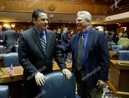 Scott Pelath, P. Eric Turner Rep. Scott Pelath, D-Michigan City, left, is welcomed by Rep. P. Eric Turner, R-Cicero, as they arrived on the opening day of the session in the House chamber at the Statehouse in Indianapolis