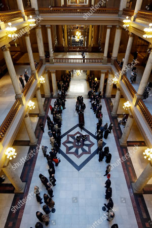 The casket containing former Indiana Congressman Andrew Jacobs Jr. is wheeled out of the Statehouse following a funeral service, in Indianapolis. Jacobs died Saturday, Dec. 28, 2013, at age 81
