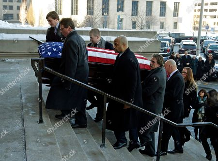 Pallbearers carry the casket containing the remains of former Indiana Congressman Andrew Jacobs Jr. into the Statehouse for visitation and a funeral service, in Indianapolis. Jacobs died Saturday, Dec. 28. 2013 at age 81