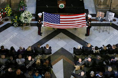 The Honor Guard folds the American flag that covered the casket of former Indiana Congressman Andrew Jacobs Jr. during a funeral service at the Statehouse, in Indianapolis. Jacobs died Saturday, Dec. 28, 2013, at age 81