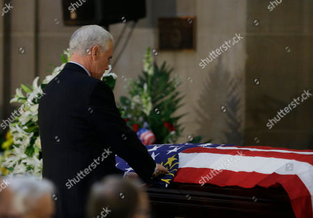 Indiana Gov. Mike Pence pauses at the casket containing former Indiana Congressman Andrew Jacobs Jr. after speaking at a memorial service at the Statehouse, in Indianapolis. Jacobs died Saturday, Dec. 28. 2013, at age 81