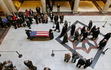 The casket containing the remains of former Indiana Congressman Andrew Jacobs Jr. is wheeled into the Statehouse for visitation and a funeral service, in Indianapolis. Jacobs died Saturday, Dec. 28. 2013 at age 81