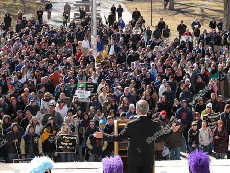 Hundreds of abortion opponents rally outside the Kansas Statehouse and hear a speech by U.S. Rep. Tim Huelskamp, in Topeka, Kan. The demonstrators were marking the anniversary of the U.S. Supreme Court decision legalizing abortion across the nation