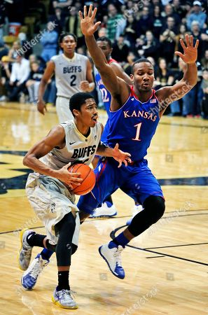 Spencer Dinwiddie, Wayne Selden Jr Colorado's Spencer Dinwiddie, left, moves the ball down the court, covered by Kansas' Wayne Selden Jr., during the second half of an NCAA college basketball game in Boulder, Colo., . Colorado won 75-72