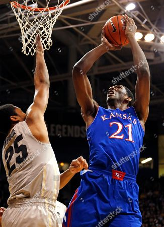 Joel Embiid, Spencer Dinwiddie Kansas' Joel Embiid, right, shoots over Colorado's Spencer Dinwiddie, during the first half of an NCAA college basketball game, in Boulder, Colo