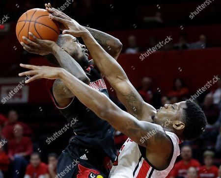 Craig Brown, Russ Smith UsaRutgers guard Craig Brown, right, tries to block a shot by Louisville guard Russ Smith during the second half of an NCAA college basketball game in Piscataway, N.J., . Louisville won 83-76