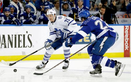 Jean-Philippe Cote, David Clarkson Toronto Maple Leafs right wing David Clarkson (71) cuts around Tampa Bay Lightning defenseman Jean-Philippe Cote (22) during the first period of an NHL hockey game, in Tampa, Fla
