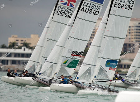 Pippa Wilson and John Gimson, left, from Great Britain, Jason Waterhouse and Lisa Darmanin, center, from Australia, and Iker Martinez and Tara Pacheco, right, from Spain, make the turn duringa World Cup sailing races, in Miami