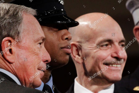 September Portuondo-Smith, Michael Bloomerg, Salvatore Cassano Firefighter September Portuondo-Smith, center, poses for a photograph with Mayor Michael Bloomberg, left, and Fire Commissioner Salvatore Cassano in a fire department graduation ceremony, in the Brooklyn borough of New York. The 242 graduates is the most diverse in the Fire Department's history with 62 percent of its members identifying as minorities, including 24 percent as black and 36 percent as Hispanic