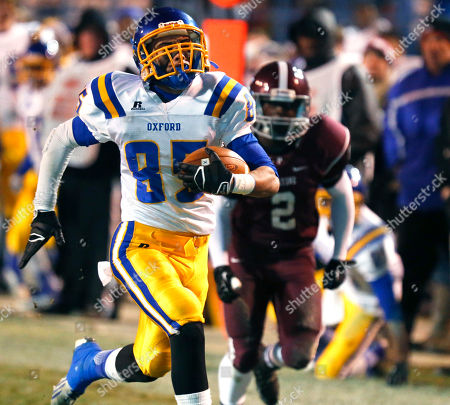 Tommy Knight, Deandre Anderson Oxford wide receiver Tommy Knight (85) sprints into the end zone past Picayune defensive back Deandre Anderson (2) in the first half of the Mississippi High School Activities Association Class 5A State Football Championship game, in Jackson, Miss