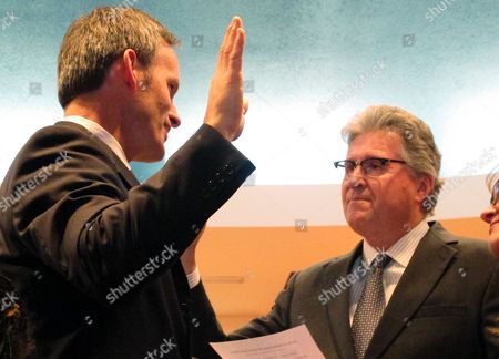 Brian Morris U.S. District Judge Dana Christiansen, right, swears in Brian Morris as Montana's newest federal judge on . Morris resigned from the Montana Supreme Court to take the lifetime federal appointment