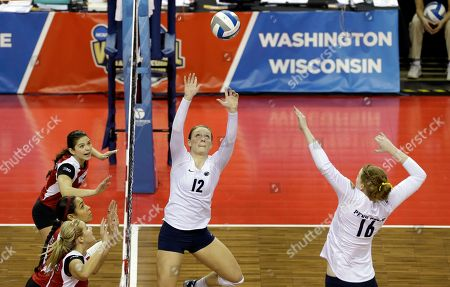 Micha Hancock, Katie Slay Penn State's Micha Hancock (12) sets the ball for Katie Slay (16) as Wisconsin defenders get in position in an NCAA women's volleyball tournament championship final, in Seattle