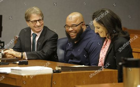 Gerard Richardson, Vanessa Potkin, Barry Scheck Gerard Richardson, center, laughs with his attorneys Barry Scheck, left, and Vanessa Potkin, a senior attorney at the Innocence Project, as they wait for a judge to appear during hearing, in Somerville, N.J. A Somerset County prosecutor told judge Julie Marino that his office wants to dismiss the indictment against Richardson, who was convicted in 1995 largely on bite-mark evidence taken from the 19-year-old Monica Reyes' back. Attorneys from the Innocence Project challenged the bite-mark evidence, and it was eventually determined the bite mark contained another man's DNA
