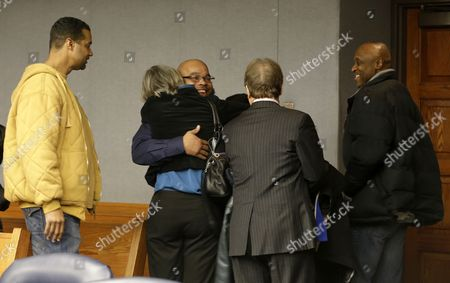 Gerard Richardson, Karen Wolff, Barry Scheck, Kevin Richardson, Mark Green Gerard Richardson, center, is hugged by Karen Wolff, a social worker with the Innocence Project, as family looks on moments after Richardson was exonerated on murder charges, in Somerville, N.J. Richardson's brother, Kevin Richardson, left, his attorney Barry Scheck, center, and his brother-in-law Mark Green look on during the embrace. A Somerset County prosecutor told judge Julie Marino that his office wants to dismiss the indictment against Richardson, who was convicted in 1995 largely on bite-mark evidence taken from the 19-year-old Monica Reyes' back. Attorneys from the Innocence Project challenged the bite-mark evidence, and it was eventually determined the bite mark contained another man's DNA