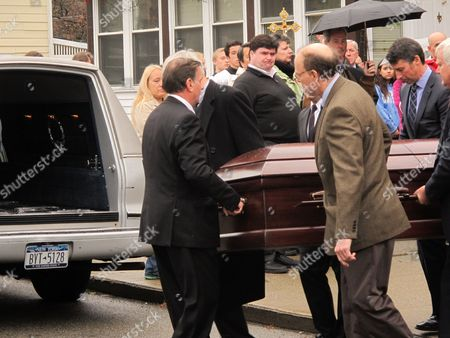 Pallbearers carry the casket to a waiting hearse after the funeral of Jim Lovell in Cold Spring, N.Y., on . Lovell and three others died when the Metro North commuter train he was riding in derailed and tumbled off the tracks on Sunday, morning, Dec. 1. Sixty others were injured in the accident