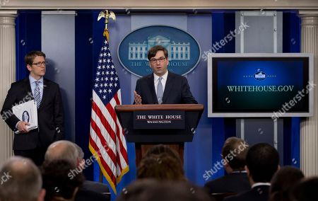 Jason Furman, Jay Carney Chairman of the Council of Economic Advisers Jason Furman speaks, as White House press secretary Jay Carney stands left, during the daily news briefing at the White House, in Washington, about the Congressional Budget Office (CBO) report and the Affordable Care Act. The federal deficit is likely to continue its slide to a lower-than-expected $514 billion for 2014, the nonpartisan CBO reported Tuesday, Feb. 4, 2014