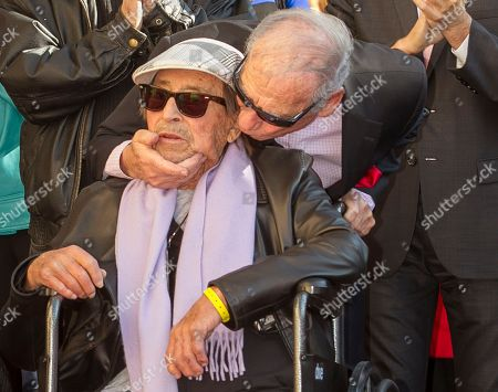 """Paul Mazursky, Mel Brooks Actor Mel Brooks, right, kisses fellow actor director Paul Mazursky, as Mazursky is honored with a star on the Hollywood Walk of Fame in Los Angeles. Mazursky, the writer-director of such films as """"Bob & Carol & Ted & Alice"""" and """"An Unmarried Woman,"""" died of pulmonary cardiac arrest Monday, June 30, 2014, at Cedars-Sinai Medical Center in Los Angeles. He was 84"""