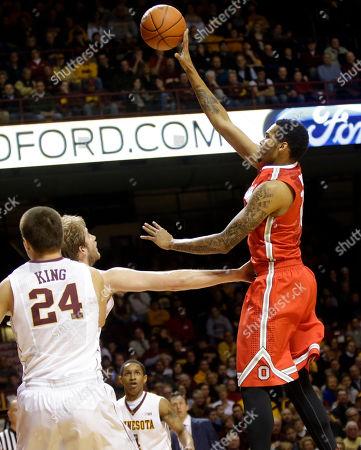 Joey King, LaQUinton Ross, Elliott Eliason Ohio State's LaQuinton Ross, right, shoots over Minnesota's Elliott Eliason and Joe King (24) in the first half of an NCAA college basketball game, in Minneapolis