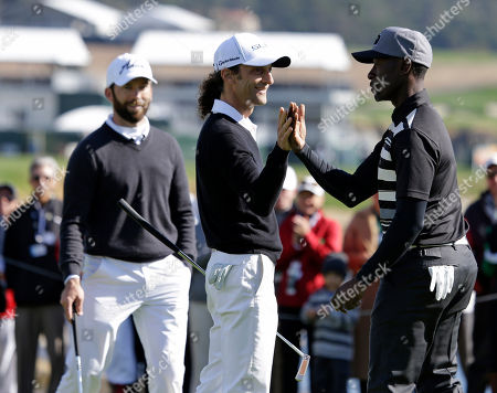 Kenny G, Lucas Black, Don Cheadle Musician Kenny G, center, greets actor Don Cheadle, right, on the 18th green of the Pebble Beach Golf Links during the celebrity shootout event of the AT&T Pebble Beach Pro-Am golf tournament, in Pebble Beach, Calif. At left is actor Lucas Black