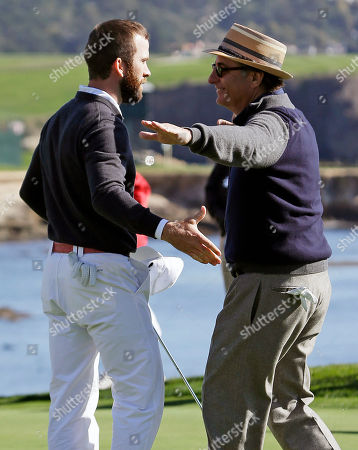 Andy Garcia, Lucas Black Actors Lucas Black, left, and Andy Garcia, right, embrace on the 18th green of the Pebble Beach Golf Links after winning the celebrity shootout event of the AT&T Pebble Beach Pro-Am golf tournament, in Pebble Beach, Calif