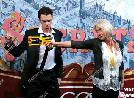 Helen Mirren Actress Helen Mirren fires a toy gun next to actor Sam Clark who plays an Al Pacino character during her roast as woman of the year by Harvard University's Hasty Pudding Theatricals in Cambridge, Mass
