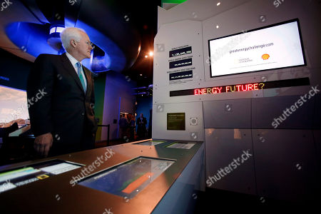 Stock Photo of John Cornyn Sen. John Cornyn, R-Texas, watches a video display in the Tom Hunt Energy Hall permanent exhibit while taking a private tour of the Perot Museum of Nature and Science, in Dallas