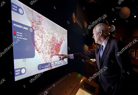 Stock Image of John Cornyn Sen. John Cornyn, R-Texas, reaches out to a video display in the Tom Hunt Energy Hall permanent exhibit while taking a private tour of the Perot Museum of Nature and Science, in Dallas