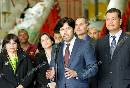 """Stock Picture of Kevin DeLeon, Alex Padilla California State Sens. Kevin DeLeon, center, and Alex Padilla speak at a news conference to announce a possible agreement in the California legislature that could lead to a statewide ban on carry-out plastic bags at supermarkets, liquor stores and pharmacies by 2016, at a plastics recycling center in Vernon, Calif., . Lawmakers in Sacramento have debated similar proposals for years, facing opposition from manufacturers that produce billions of plastic shopping bags each year. The agreement calls for using $2 million for loans and grants that could help those companies retrain workers and convert to manufacturing """"a new generation of reusable bags with the smallest environmental footprint,"""" a summary of the legislation said. Los Angeles and nearly 100 other cities and counties in the state have enacted bans on single-use plastic bags at stores"""