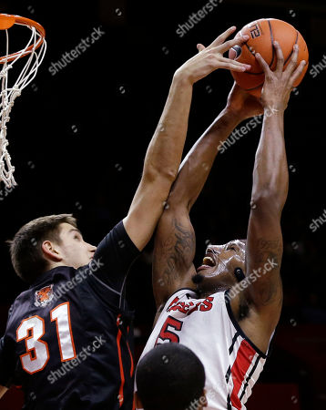 Craig Brown, Pete Miller Rutgers forward Craig Brown (15) tries to control the ball as Princeton forward Pete Miller (31) tries to make a steal during the first half of an NCAA college basketball game in Piscataway, N.J