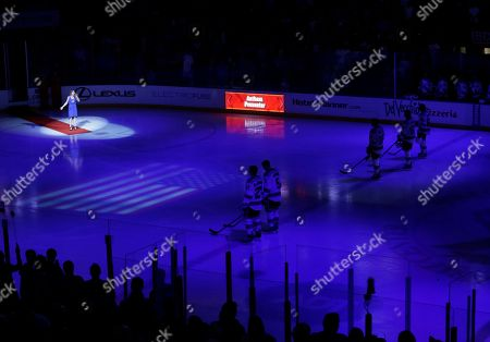 Ariel Rose Ariel Rose, upper left, sings the National Anthem before the start of an NHL hockey game between the Florida Panthers and the New York Rangers, in Sunrise, Fla