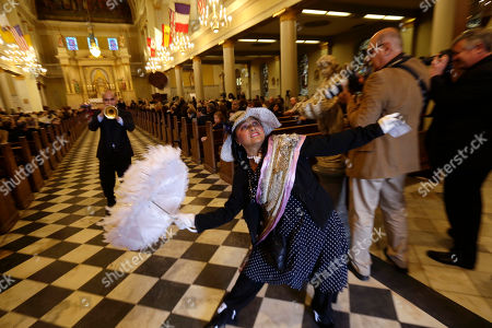 Jennifer Jones, Irvin Mayfield Performer Jennifer Jones dances a second-line dance as trumpeter Irvin Mayfield plays at the conclusion of a funeral Mass for artist George Rodrigue, who painted scenes from Cajun country but became famous for his round-eyed, perk-eared Blue Dog, at St. Louis Cathedral in New Orleans, . Rodrigue died Saturday of cancer. He was 69. A native of southwest Louisiana, he began painting at age 9, when he had polio and his mother brought him paint-by-number kits. He began art lessons when he was 12