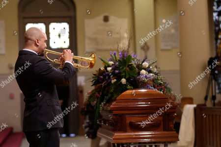 Irvin Mayfield Trumpeter Irvin Mayfield performs during a funeral Mass for artist George Rodrigue, who painted scenes from Cajun country but became famous for his round-eyed, perk-eared Blue Dog, at St. Louis Cathedral in New Orleans, . Rodrigue died Saturday of cancer. He was 69. Rodrigue, a native of southwest Louisiana, began painting at age 9, when he had polio and his mother brought him paint-by-number kits. He began art lessons when he was 12