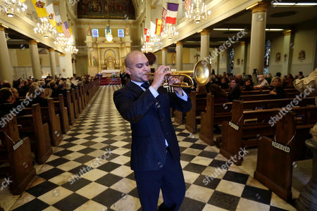 Irvin Mayfield Trumpeter Irvin Mayfield plays at the conclusion of a funeral Mass for artist George Rodrigue, who painted scenes from Cajun country but became famous for his round-eyed, perk-eared Blue Dog, at St. Louis Cathedral in New Orleans, . Rodrigue died Saturday of cancer. He was 69. A native of southwest Louisiana, he began painting at age 9, when he had polio and his mother brought him paint-by-number kits. He began art lessons when he was 12