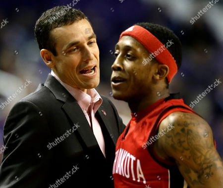 Joey James South Dakota coach Joey James talks to Trey Norris during the first half of an NCAA college basketball game against the Kansas State, in Manhattan, Kan