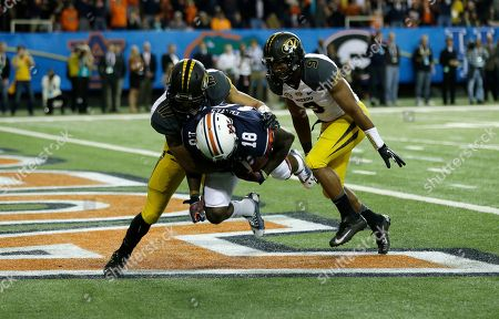 Auburn wide receiver Sammie Coates (18) makes a touch-down catch against Missouri safety Matt White (17) during the first half of the Southeastern Conference NCAA football championship game, in Atlanta