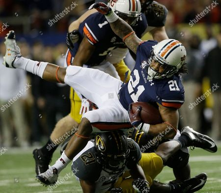 Auburn running back Tre Mason (21) moves into the end zone against Missouri safety Matt White (17) during the first half of the Southeastern Conference NCAA football championship game, in Atlanta
