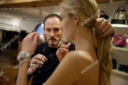 Josep Font Josep Font, creative director of DelPozo, left, works with a model to prepare for Fashion Week in New York. Font is one of the up-and-coming Hispanic designers that will present his work during this week's Fashion Week