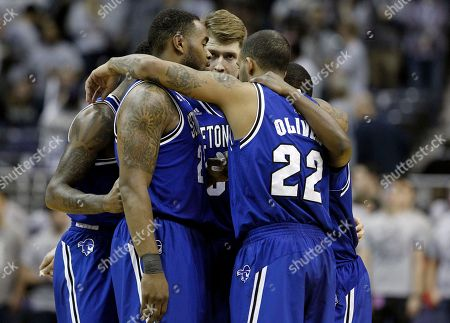 Fuquan Edwin, Gene Teague, Patrik Auda, Sterling Gibbs, Brian Oliver Seton Hall guard/forward Fuquan Edwin (23), center Gene Teague (21), forward Patrik Auda (33), guard Sterling Gibbs (4) and guard/forward Brian Oliver (22) huddle before the first half of an NCAA college basketball game against Georgetown, in Washington