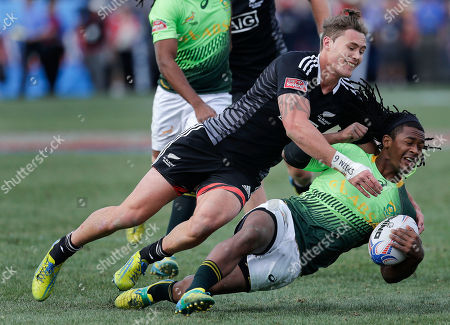 Gillies Kaka, Branco du Preez New Zealand's Gillies Kaka, left, takes down South Africa's Branco du Preez, right, during the cup finals of the Sevens Rugby tournament, in Las Vegas