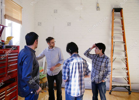 Hardware engineer manager Eric Barber, left to right, brainstorms development of the Copenhagen Wheel, a human/electric hybrid bicycle engine, with vehicle design engineer Jon Stevens, mechanical and software engineer Julian Fong and hardware designer and embedded programmer James Simard at Superpedestrian, the hybrid engine's manufacturer in Cambridge, Mass. Pre-orders for the Copenhagen Wheel are being taken with delivery expected by May 2014
